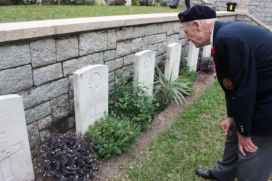 "Signaler (Retired) Horace ""Gerry"" Gerrard, a Second World War Veteran, takes a moment to quietly reflect on his comrades who were killed during the Battle of Hong Kong. Sig (Retd) Gerrard, 95, and other Canadian Veterans attended a ceremony marking the 70th anniversary of the battle at the Sai Wan War Cemetery in Hong Kong on December 4, 2011. Photo: ©2011 Veterans Affairs Canada."