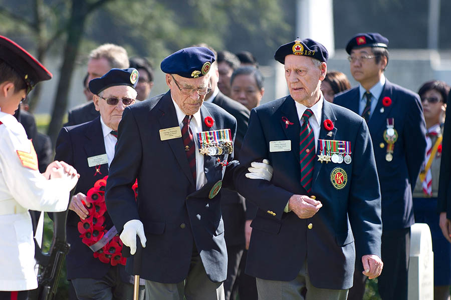 "Signaler (Retired) Horace ""Gerry"" Gerrard, 95, a Second World War Veteran, and other Canadian Veterans attend a ceremony marking the 70th anniversary of the battle at the Sai Wan War Cemetery in Hong Kong on December 4, 2011. Photo: ©2011 Veterans Affairs Canada."