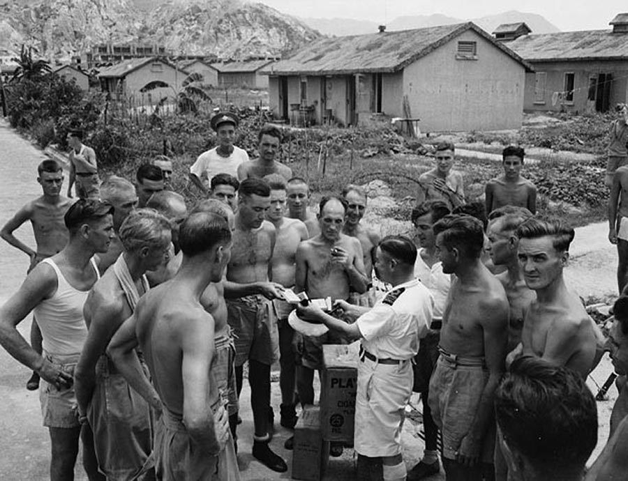 Liberated Canadian prisoners of war at Sham Shui Po camp, Hong Kong, August 1945. Photo: Library and Archives Canada.